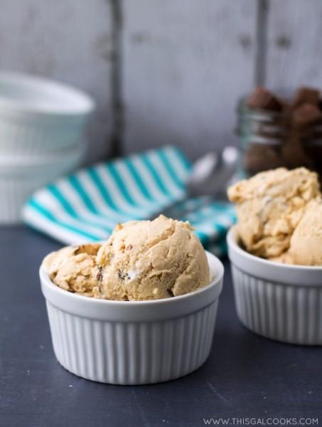 Fluffernutter Peanut Butter Cup Ice Cream. Homemade Ice Cream made with peanut butter, marshmallow fluff and peanut butter cups! From www.thisgalcooks.com #peanutbutter #icecream