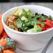 Slow Cooker Chicken Enchilada Rice Bowls from www.thisgalcooks.com. The chicken cooks in a #slowcooker, the rice in a rice cook slider