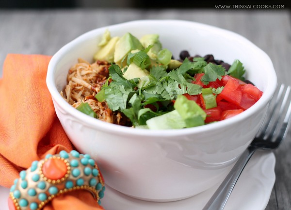 Slow Cooker Chicken Enchilada Rice Bowls from www.thisgalcooks.com. The chicken cooks in a #slowcooker, the rice in a rice cooker and all you have to do is make the sauce and prepare your toppings 3WM