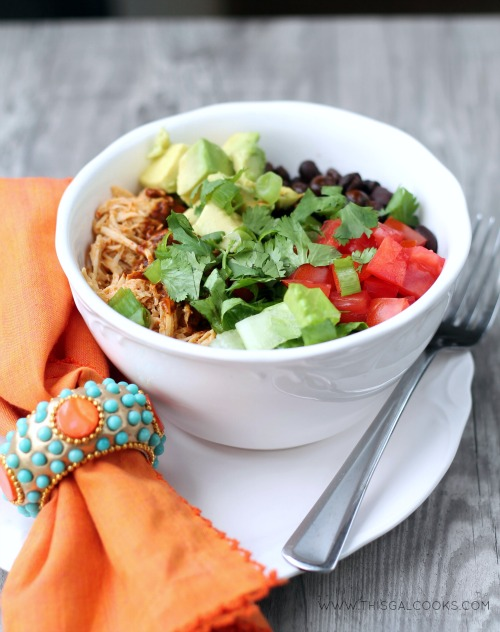 Slow Cooker Chicken Enchilada Rice Bowls from www.thisgalcooks.com. The chicken cooks in a #slowcooker, the rice in a rice cooker and all you have to do is make the sauce and prepare your toppings5WM