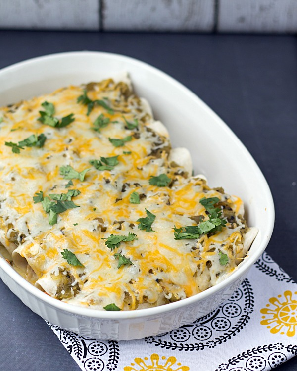 Green Sauce Chicken Enchiladas are a quick and easy, cheesy Mexican style dinner recipe that you will love!   This Gal Cooks