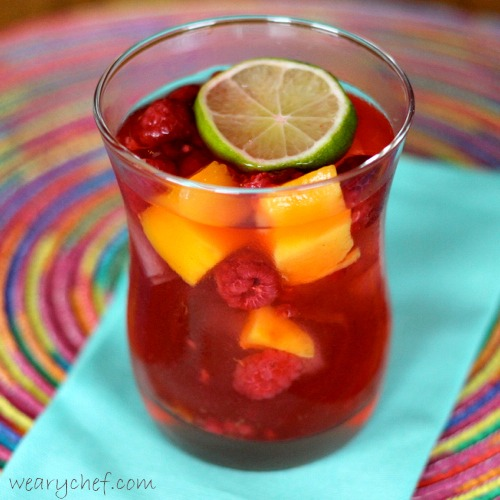 Very Pink Sangria with Raspberries and Mangoes by The Weary Chef