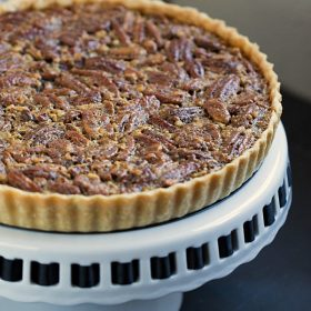 Classic Pecan Pie Tart - This Gal Cooks. This pecan pie is spiced up with the addition of cinnamon and spiced rum!