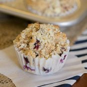 Healthier Blueberry Muffins - This Gal Cooks. Tasty muffins made with whole wheat, flax, honey, Greek Yogurt and blueberries. Topped with chopped almonds.