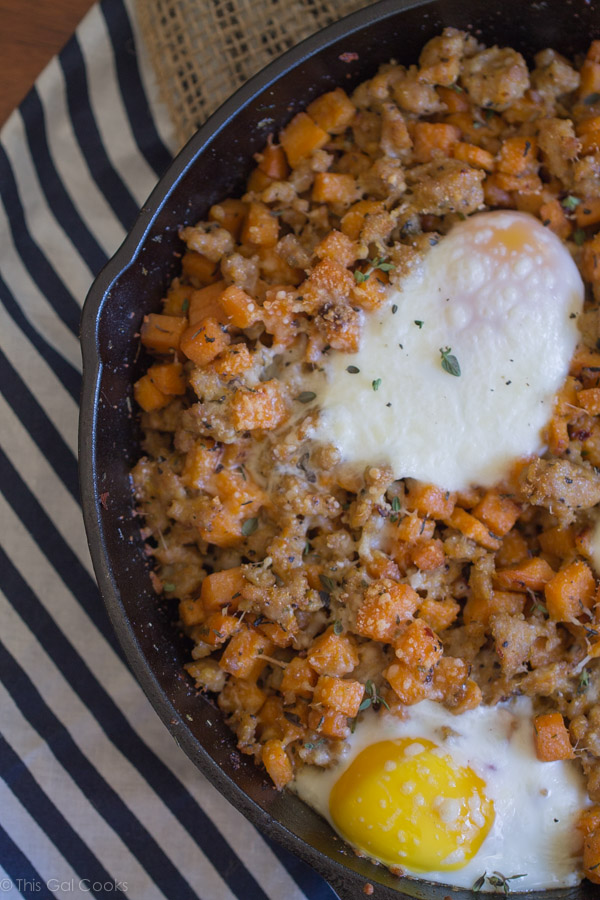 Chicken Sausage and Sweet Potato Hash with Baked Eggs is one of my favorite savory breakfast dishes. Perfectly seasoned, sauteed potatoes with perfectly baked eggs. A MUST try! | This Gal Cooks