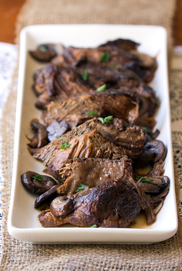 Crock Pot Beef Burgundy is my go to recipe for comfort food when I don't want to spend a lot of time in the kitchen. Perfectly paired with rice or mashed potatoes. | This Gal Cooks