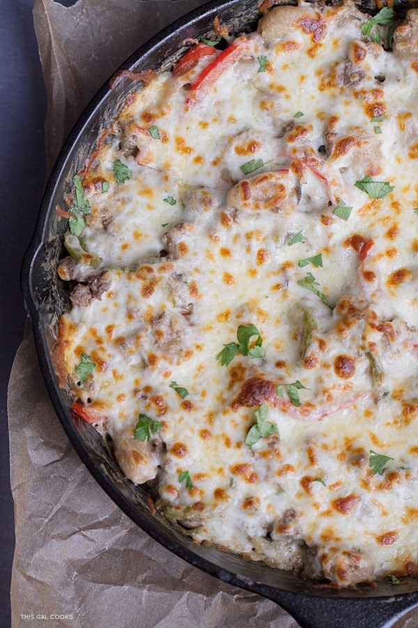 Thirty Minute Philly Cheeseburger Gnocchi Bake: Low fat cream cheese, lean ground beef and whole wheat gnocchi come together to create this quick and easy one pan skillet dinner.