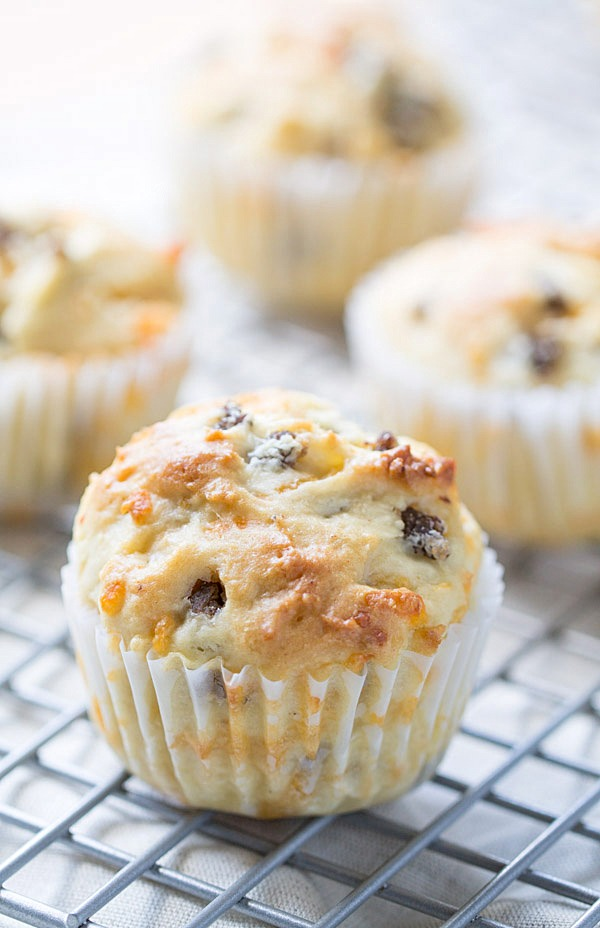 We LOVE to begin our day with these savory Sausage Cheddar and Olive Oil Muffins. Perfect for a quick breakfast or to enjoy with a cup of coffee! | This Gal Cooks #PantryInsiders