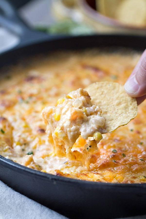 Cheesy Chipotle Shrimp and Corn Dip is my new favorite dip! It's cheesy. It's spicy. It's creamy. It's the kind of appetizer you want to stuff your face with. Perfect for game day! | This Gal Cooks