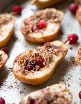 Baked Pears with Honey, Cranberries and Pecans is a super simple and healthy dessert recipe. These delicious pears are seasoned with cinnamon and nutmeg for an extra boost of guilt free flavor!