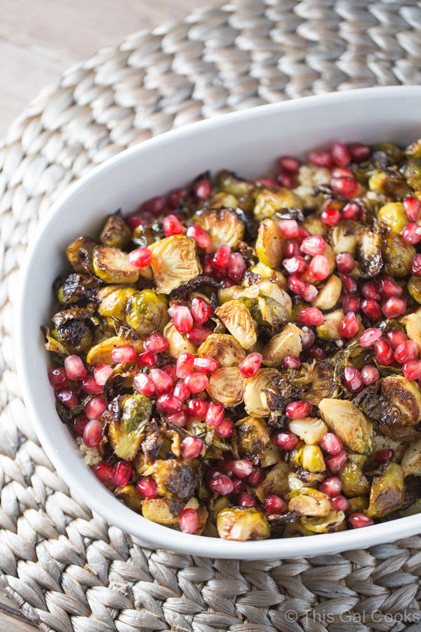 Roasted Brussels Sprouts and shallots are tossed with balsamic vinegar, topped over a bed of fluffy quinoa and then sprinkled with fresh pomegranate!