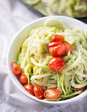 Simple and healthy, these zucchini noodles are paired with roasted tomatoes and a light white wine sauce. Cooked in one skillet to cut back on the clean-up.