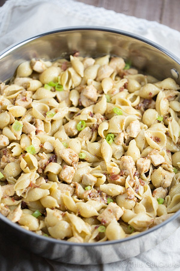 One Pan Chicken Bacon Honey Mustard Pasta is a delicious and simple one pot meal that's perfect for those busy weeknights. Creamy honey mustard is tossed with chicken, bacon, swiss and pasta. It's comfort food in a pan!