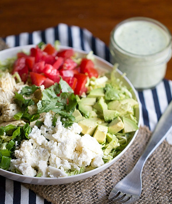 Shaved Brussels Sprout Salad with Creamy Cilantro Dressing is a simple and flavorful salad that's perfect for lunch or a light dinner. This salad is packed with chicken, avocado, tomatoes and queso fresco!