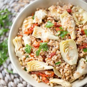 Farro Salad is packed full of tender sun dried tomatoes, artichokes and crunchy pine nuts. Tossed with an olive oil, red wine and Greek seasoning dressing for an outstanding pop of flavor!