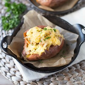 These healthier Breakfast Sweet Potatoes are stuffed with scrambled eggs, chicken sausage, and shredded smoked gouda cheese. Only 300 calories per serving, low fat and low sugar!