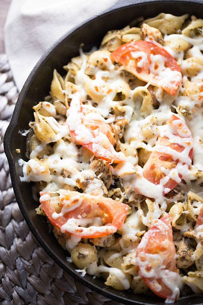 Pesto Chicken Pizza Pasta is a simple dinner recipe that uses ingredients that you may already have stocked in your pantry. This delicious dinner recipe is ready to devour in under 30 minutes!