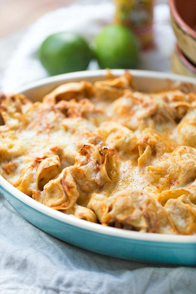 Easy Chicken Enchilada Tortellini Bake. Ready for dinner in under 30 minutes!   This Gal Cooks