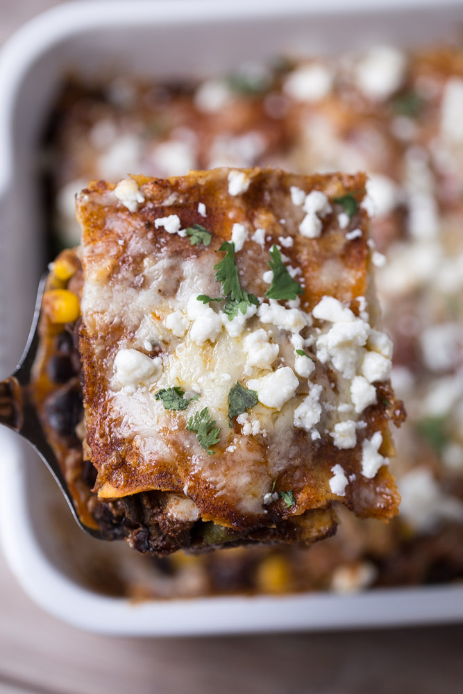 This Vegetarian Enchilada Casserole is a Tex-Mex lover's dream! Only 475 calories per serving!   This Gal Cooks
