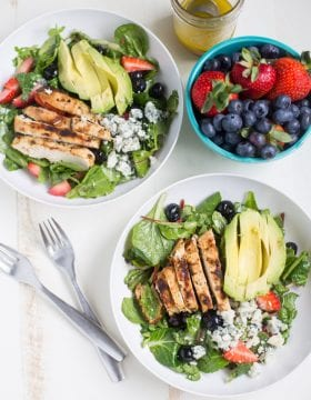 Gorgonzola Chicken Salad with Berries and Avocado is a fresh and healthy salad full of fresh fruit, gorgonzola, super greens and it's dressed with homemade honey balsamic vinaigrette!