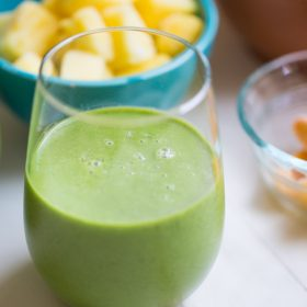 Tropical Kale Smoothie is packed with tons of healthy kale! Mango and pineapple add a bit of sweetness and tropical flavor and plain yogurt make it irresistibly creamy.