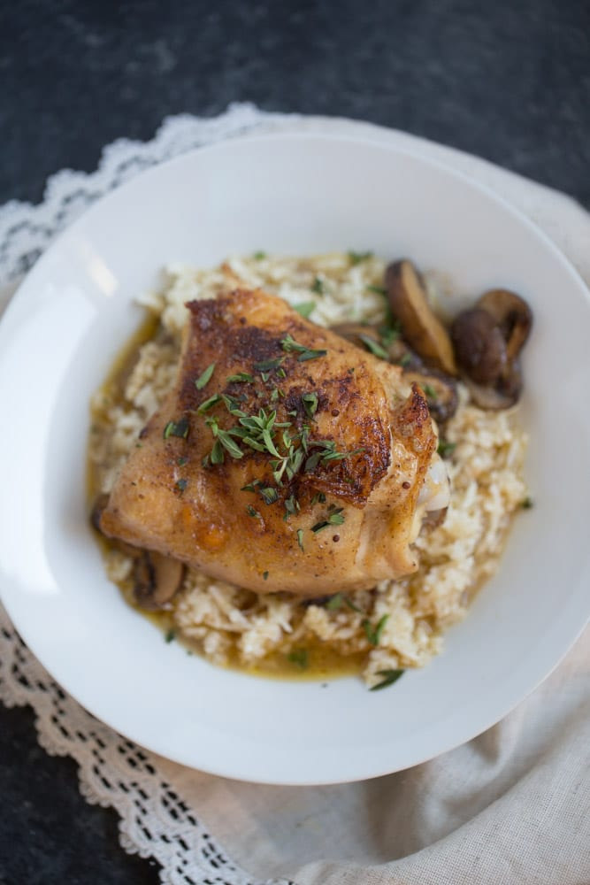 One Skillet Chicken Thighs and Mushrooms with Cauliflower Rice is an easy one skillet dinner recipe that's ready to eat in under an hour. It's low carb and gluten free and is made with real ingredients.