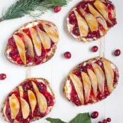 Cranberry Pear Flatbread. This super simple appetizer recipe makes a great addition to your Christmas appetizer menu! Great for snacking too!