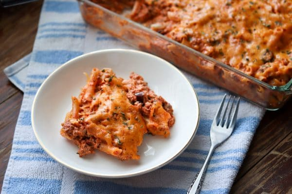 Easy gluten free pasta casserole is made with penne pasta, lean ground beef and ricotta cheese. This filling and delicious casserole will feed a crowd or provide a small family with lots of leftovers!
