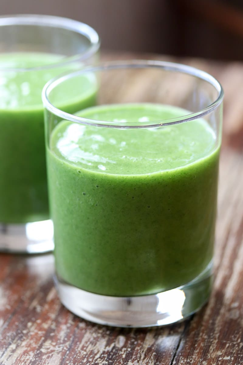 This healthy, nutrient dense paleo and Whole30 compliant mango pineapple kale smoothie tastes great even though there's a lot of something you may not like in it - kale!