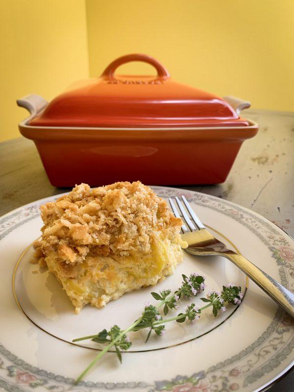 squash-casserole-beside-le-creuset-heritage-covered-square-casserole-dish